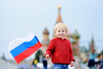 Toddler boy holding russian flag