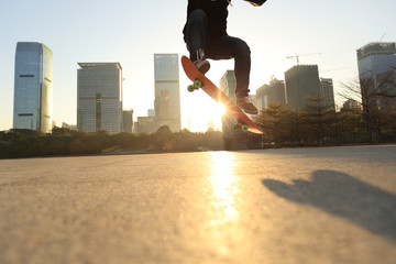 skateboarder doing an ollie trick at sunrise city