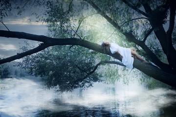 woman lying on a tree