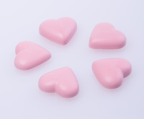 chocolate in pink colour or love shape chocolate.