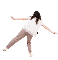 Balancing young woman.  or dodge falling woman. Rear view people collection.  backside view of person.  Isolated over white background. Long-haired curly girl balancing on one leg.