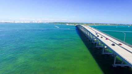 Vehicles travel along the Rickenbacker Causeway in Miami