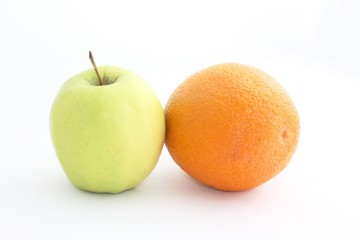 Yellow Apple and orange on a white background