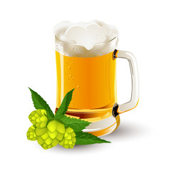 glass of beer with hop cones