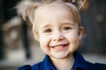 Portrait of smiling little girl with deep green eyes