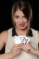 beautiful smiling woman holds in her hands a winning combination of cards