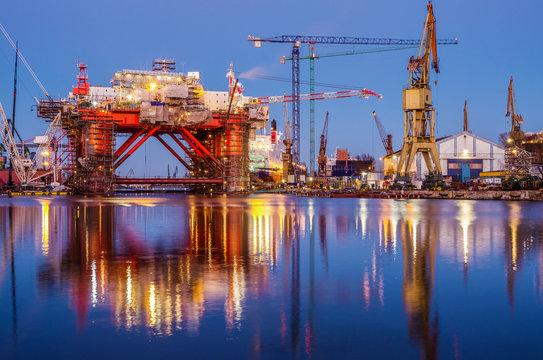 The oil platform under construction in the shipyard at night. Gdansk. Poland.