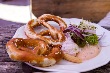 Pretzel with cream cheese on the plate