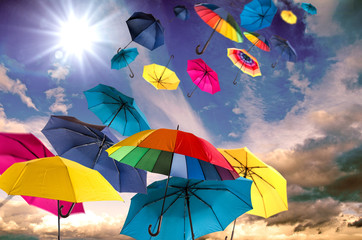 Happiness, lust for life: flying colorful umbrellas on in front of blue sky :)