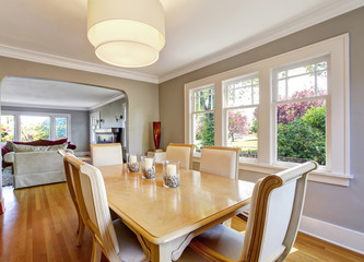 Open floor plan dining room with table set and hardwood floor.