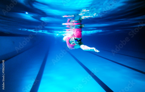 woman swimming freestyle under water shoot of a woman swimming freestyle in olympic pool - Olympic Swimming Pool Underwater
