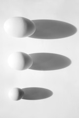 Three eggs of different sizes
