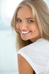 Beauty Woman Portrait. Girl With Beautiful Face Smiling. High Resolution Image