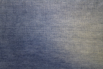 Texture of blue jeans textile background