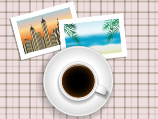cup of coffee or tea and pictures of travel on the table