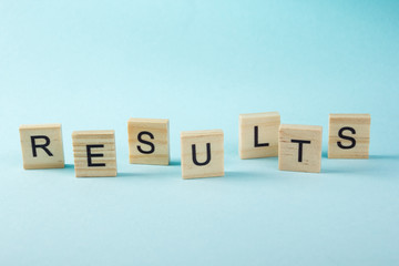 Results word on blue. Succeed business success, be a winner in  elections, pop poll or sports test,  report, election result. Counting losses and profit, analyzing financial statistics