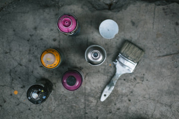 Street art equipment, spray cans and brush
