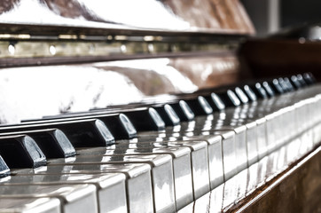 Piano keyboard n a light tone with selective focus and blurred background.