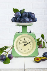Plum fruit on old vintage scale 1960. One division of 20 grams. Only for domestic use