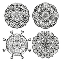 Set of round decorative ornaments, black and white floral pattern