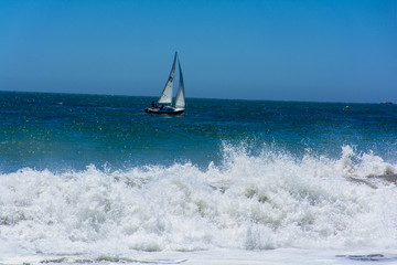 Sailing Boat with Pacific Huge Wave