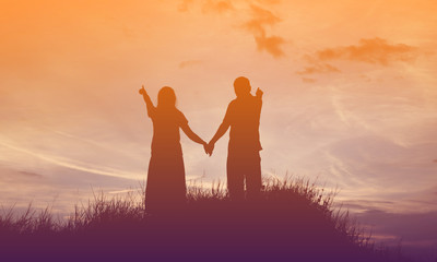 Young couple in love at sunset on the Mountain
