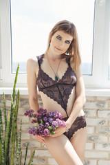Young beautiful sexy woman posing