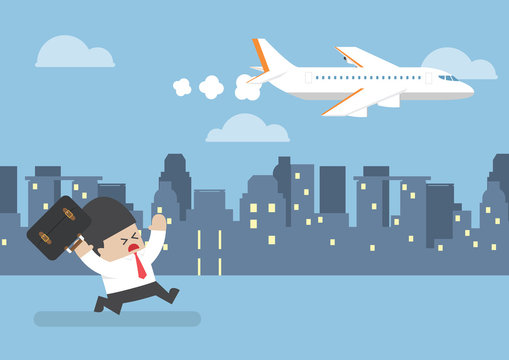 Businessman who missed his flight running behind a plane