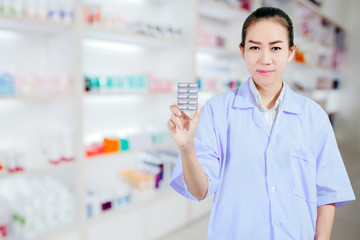 Pharmacist and Doctor woman holding pill in hand , health care a