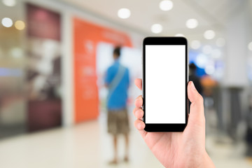 Smart phone with white screen in hand on blurred in shopping mal