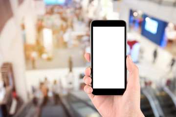 Smart phone with white screen in hand on blurred in shopping mall background