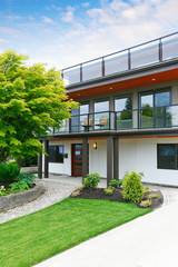 Modern three level house exterior with wooden trim