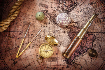 Fototapete - Old compass and telescope on vintage map. Retro style.