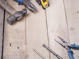 Construction tools on wooden background. Copy space for text. Set of assorted work tool at wood table . Top view