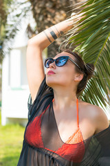 Portrait of the beautiful sexy woman in a sunglasses in front of