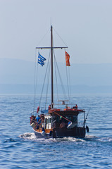 Excursion ship on a tour near Amoulani island in Greece