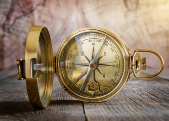 Fototapete - Old compass on the vintage map background. Retro style.