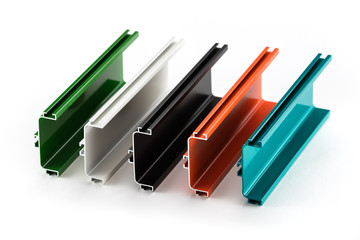 Samples of colorful aluminum profiles over white background