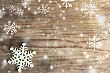 Winter background with snowflake on wooden background. Snow effect