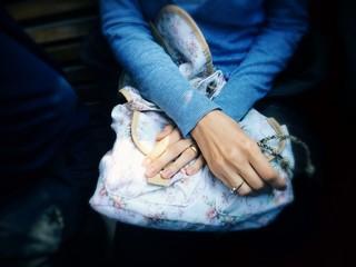Hands on old bag