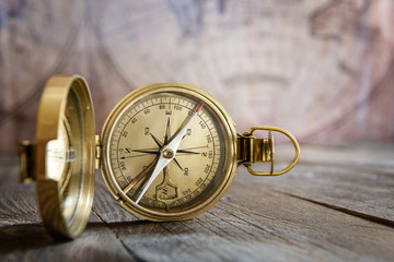 Wall Mural - Old compass on the vintage map background. Retro style.