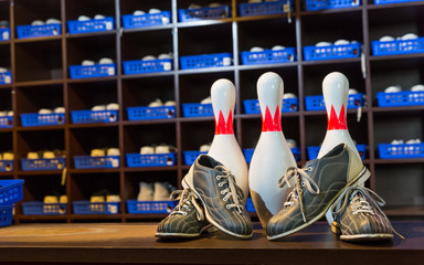 Bowling shoes and pins