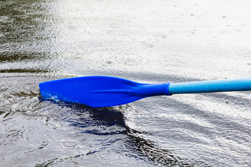 paddle blade in water during boating on the pond