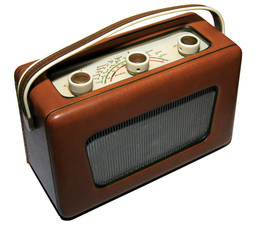 Old vintage 1950s radio with faux leather front and grille isolated on a white background