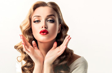 Beautiful  vintage pin-up girl send air kiss . Model with curly hair and bright makeup with red lips.