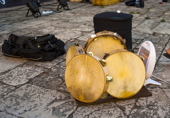 the skin of the tambourines of a folk band of heated Puglia to improve the sound. Italy.Note the presence of an electric heater.
