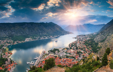 Panoramic landscape Kotor bay in Montenegro at sunset. Dramatic evening light. Balkans, Adriatic sea, Europe. View from the top of the mountain. Fotomurales