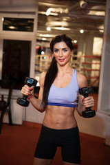 Woman with weights in gym