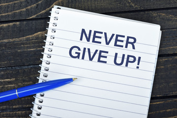 Never Give Up text on notepad