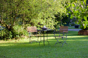 Table and chairs on a lawn at the garden